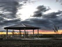Abrigo de la comida campestre en la salida del sol Imagenes de archivo