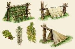 Abrigos da sobrevivência nas madeiras imagens de stock