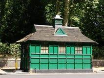 Abrigos do táxi do verde de Londres Imagens de Stock