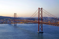 25 Abril bridge in Lisbon Portugal by twilight Stock Photos
