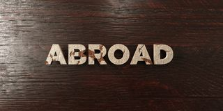 Abroad - grungy wooden headline on Maple  - 3D rendered royalty free stock image. This image can be used for an online website banner ad or a print postcard Royalty Free Stock Photography
