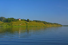 Abrupt bank of Oka river in Kasimov city, Russia. View of the coast of Oka river from motorship in Kasimov, Ryazan region, Russia royalty free stock images