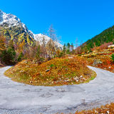 Abrupt Bend. In the Asphalt Road in the Italian Alps royalty free stock images