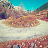 Abrupt Bend. In the Asphalt Road in the Italian Alps, Instagram Effect stock image