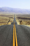 Abrupt bends of road on  the Californian steppes Royalty Free Stock Photos