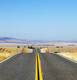 Abrupt bends of road on  steppes Royalty Free Stock Images