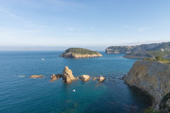 Abrupt Javea coastline. At Portichol bay, with its landmark island in the background stock photo