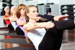 Abs. Group of young women in the gym centre Stock Photography