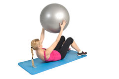 Abs exercise with fitness ball. Female lying abs crunching exercise with fitness ball. position 2 of 2 Stock Photo