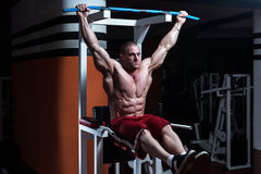 Abs Exercise For Six Pack. Handsome Man Exercising His Abs At The Gym Royalty Free Stock Photography