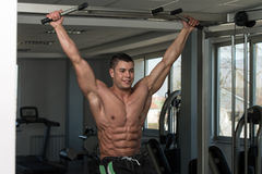 Abs Exercise For Six Pack. Healthy Man Exercising His Abs At The Gym Stock Photo