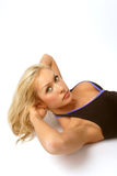 Abs training. Beautiful blondie training her abs Stock Photo
