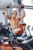 Abs workout in the gym. Athletic man doing abs workout in the gym Royalty Free Stock Photos