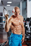 Abs workout in the gym. Athletic man doing abs workout in the gym Royalty Free Stock Photography