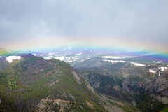 Absaroka Mountains. The Absaroka Mountains being spanned by a rainbow Stock Image