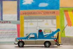 Abschleppwagen geparkt in der mechanischen Garage Lizenzfreie Stockfotos