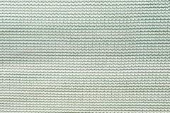 Abschluss herauf grünes Nylonnetz mit einem Knotenmuster für Hintergrundhintergrund lizenzfreies stockfoto