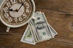 Abschluss oben, Zeit und Geld Lizenzfreie Stockfotos