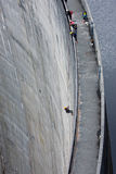 Abseiling on Gordon Dam in Tasmania. In wilderness area royalty free stock photos