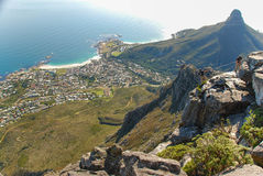 Abseiling on Table Mountain, Cape Town. Abseiling on Table Mountain with the Lion's Head in the background, Cape Town royalty free stock image