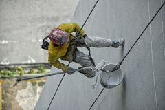 ABSEILING. Worker abseiling down side of building in Kuala Lumpur Malaysia stock photos