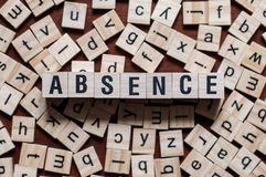 Absence word on building blocks royalty free stock photo