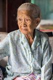 Absent-minded elderly asian women portrait Stock Images