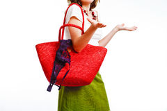 Absent-minded woman. With big red bag and bra slipping from the bag Royalty Free Stock Photography