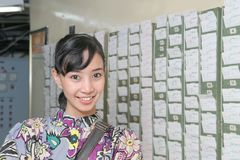 Absent punch card. Female worker at absent punch card smiling Royalty Free Stock Photography