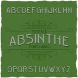 Absintetikettstilsorten och prövkopiaetiketten planlägger med garnering Arkivbilder
