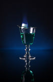 Absinth. A glass of absinthe with burning sugar upon stock photo