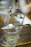 Absinth glass and fountain. Classic ritual of glass of absinth and dripping fountain Stock Photography