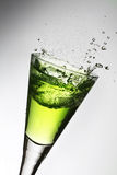 Absinthe. Splash in a glass, green absinthe.Ready to drink royalty free stock photos