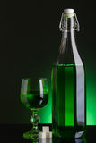 Absinthe bottle and glass Royalty Free Stock Image