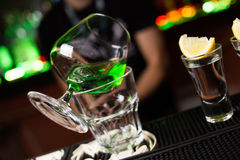 Absinthe and cocktails with lemon. An alcoholic cocktails and absinthe is in beautiful glass, in the restaurant royalty free stock photo