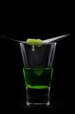 Absinthe with dropping sugar. Absinthe drink with burning sugar, dropping through a slotted spoon stock images
