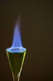 Absinthe on fire in the glass Royalty Free Stock Image