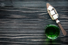 Absinthe in glass on wooden background top view mock up.  stock photography