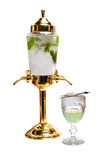 Absinthe liqueur. With leaves of mint and ice royalty free stock photography