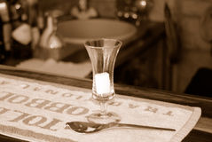 Absinthe shot. With bar background stock photo