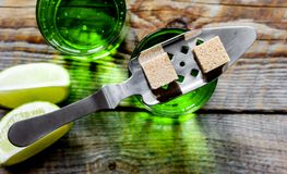Absinthe shots with lime slices and sugar on wooden table backgr Royalty Free Stock Photo