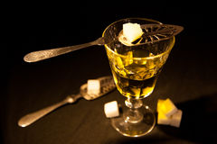 Absinthe with spoon Royalty Free Stock Photos