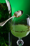 Absinthe with sugar. Close-up stock image