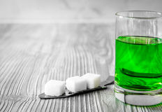 Absinthe with sugar cubes and spoon on wooden background. Close up stock image