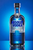 Absolut vodka on blue background. Royalty Free Stock Image