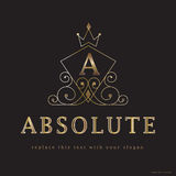 Absolute luxury logo. Ornate crown with text graphic A and gild text absolute with copyspace on black background Stock Photography