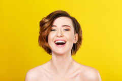 Absolute and true feeling of happiness. Happy and confident. Shot of amazingly beautiful female standing on a yellow background and sharing joyful emotions Royalty Free Stock Photo