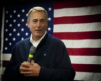 Absolutely. House Speaker John Boehner displaying a warm smile against flag backdrop during visit to Derry NH Royalty Free Stock Images