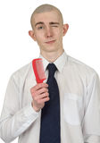 Absolutely bald guy with a hairbrush Stock Photo