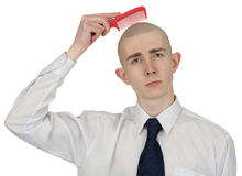 Absolutely bald guy with a hairbrush stock images